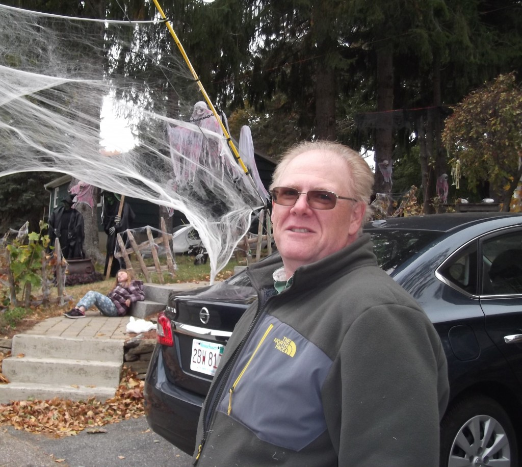 Dave Flint of Spencer in front of his Halloween display, 2015.